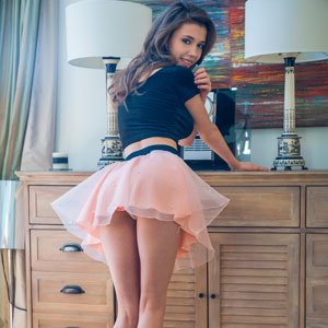 Milla Azul in pink skirt